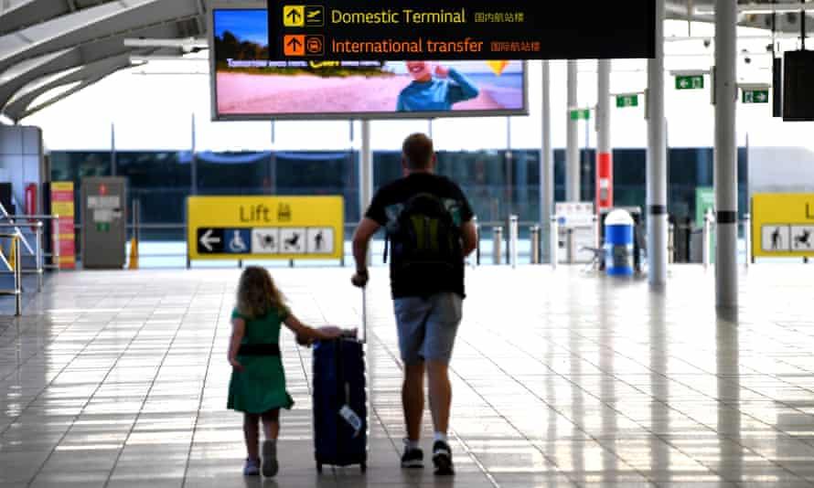 Departing passengers make their way at Brisbane airport.