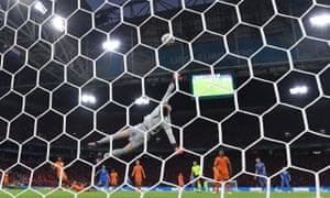 Ukraine's Andriy Yarmolenko scores their first goal as Netherlands' Maarten Stekelenburg attempts to make a save.