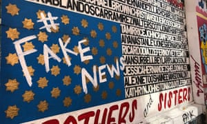 A mural with names of a number of black and Latino men killed by police was tagged '#FakeNews'.
