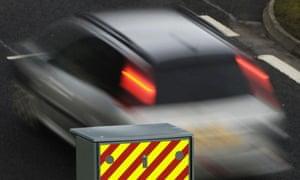 A car passes a speed camera