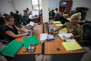 Staff at the World Health Organisation data processing centre for the Ebola vaccine clinical trials in the Guinean capital Conakry
