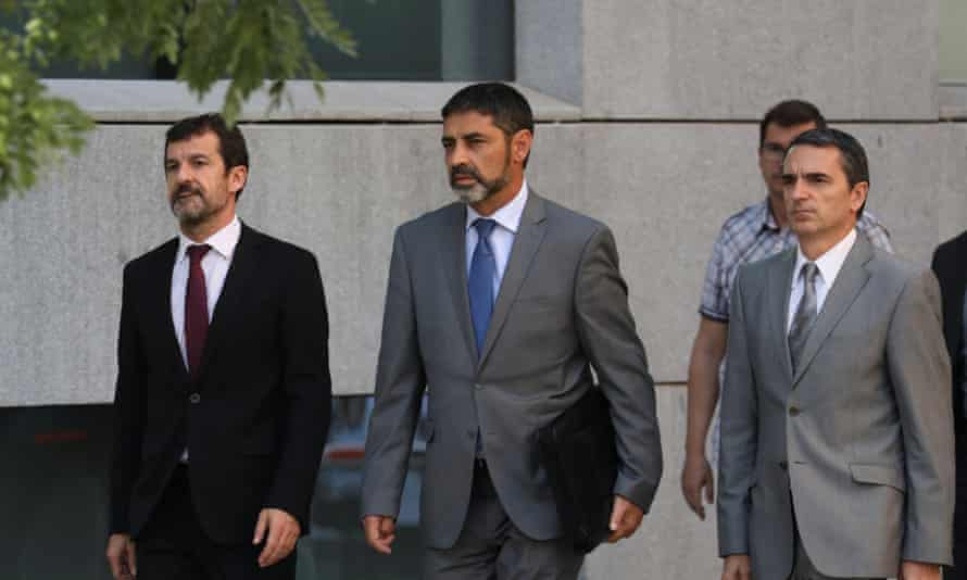 Josep Lluís Trapero, centre, the head of the Mossos d'Esquadra, the Catalan regional police force, returns to the High Court following a break in proceedings in Madrid.