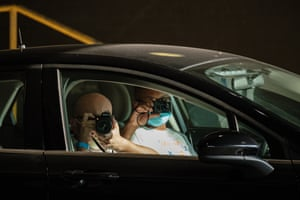 Law enforcement agents photograph protesters from an unmarked car during a protest in Cleveland, US