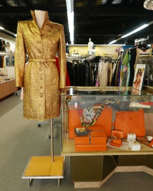 A vintage gold dress on display next to a glass cabinet showing jewellery at C Madeleine's, Miami