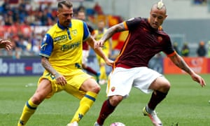 Radja Nainggolan keeps the ball while under pressure from Fabrizio Cacciatore during Roma's 3-0 win against Chievo at the weekend.