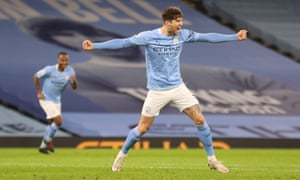 John Stones (R) of Manchester City celebrates after scoring the third goal.