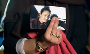 Renu, eldest sister of Shamima Begum, holds her sibling's photo while being interviewed by the media.