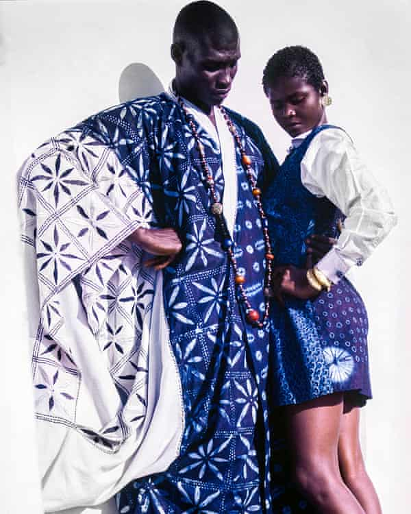 Man in robe and woman in shirt and skirt