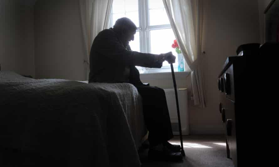 Elderly man on bed