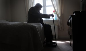 An old man in his bedroom