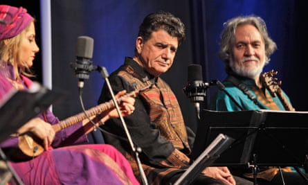 Mohammad Reza Shajarian, centre, had opposed the contested Mahmoud Ahmadinejad re-election in 2009, telling Iran's state radio to stop using his songs.