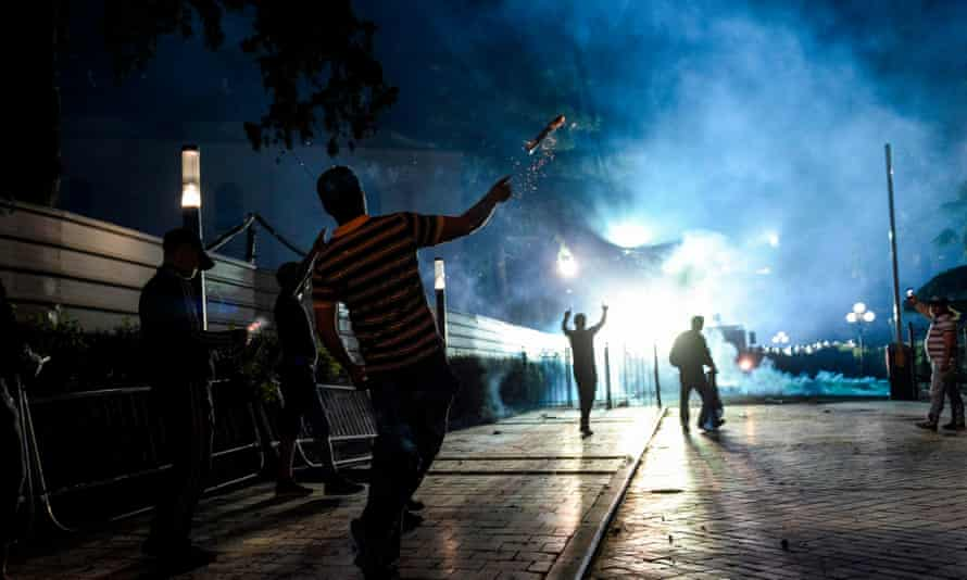 Protesters clash with police at an opposition protest in Tirana on Saturday.
