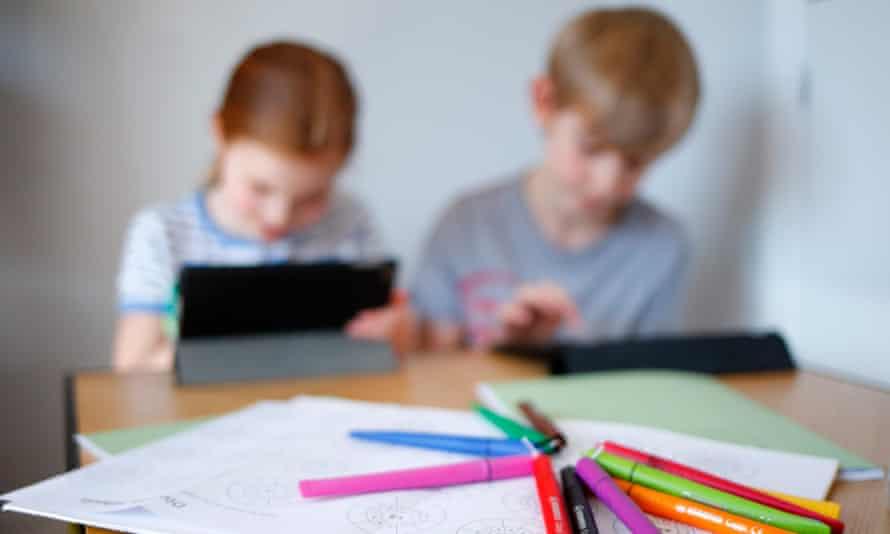 Children doing school work at home