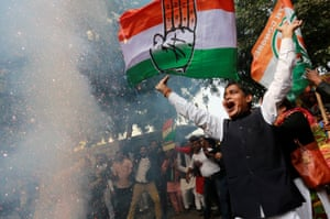 Supporters of India's main opposition Congress party celebrate after initial poll results at the party headquarters in New Delhi, India, December 11, 2018. REUTERS/Adnan Abidi
