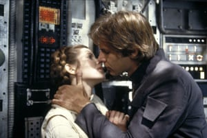 Actors Carrie Fisher and Harrison Ford kissing in The Empire Strikes Back