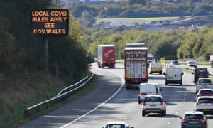 A sign on the M4 near Cardiff in Wales reminds motorists of coronavirus rules.