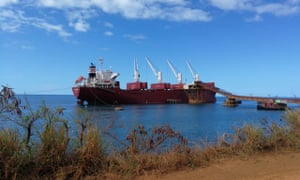 A boat transports the nickel harvested from Thio's mine to New Caledonia's capital.