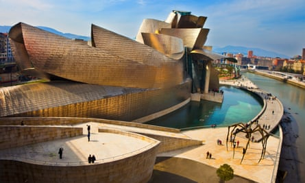 Modern architecture in Bilbao.Guggenheim Museum by Frank Gehry architect and Maman Sculpture by Louise Bourgeois.