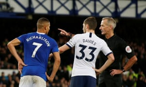 The referee Martin Atkinson awaits the VAR decision on a Tottenham penalty in their 1-1 draw at Everton.