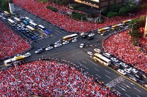 Tens of thousands of South Korean fans cheer their team in central Seoul before watching their win over Italy.