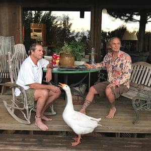 Ashley Bickerton, right, with Paul Theroux on Oahu's North Shore in 2016. Photograph: Courtesy Lehmann Maupin