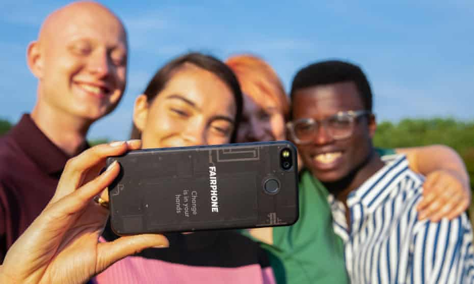 A group of people posing for a photo being taken on a Fairphone 3 smartphone