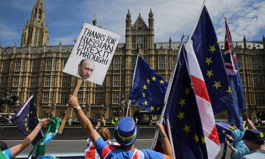 A pro-EU demonstrator holds a placard bearing an image of Russia's President Vladimir Putin, during a protest outside of the Houses of Parliament on 11 June.
