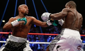 Floyd Mayweather throws a left at Andre Berto during their WBC/WBA welterweight title fight at MGM Grand Garden Arena.