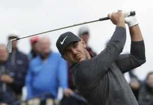 Koepka, moves to share the lead.