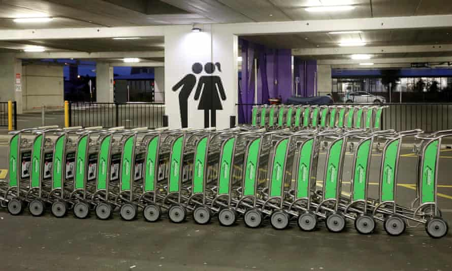 A line of unused trollies is pictured in the empty parking area at Christchurch Airport during the COVID-19 coronavirus lockdown in Christchurch on April 8, 2020.