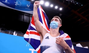 Max Whitlock of Great Britain celebrates after winning gold.