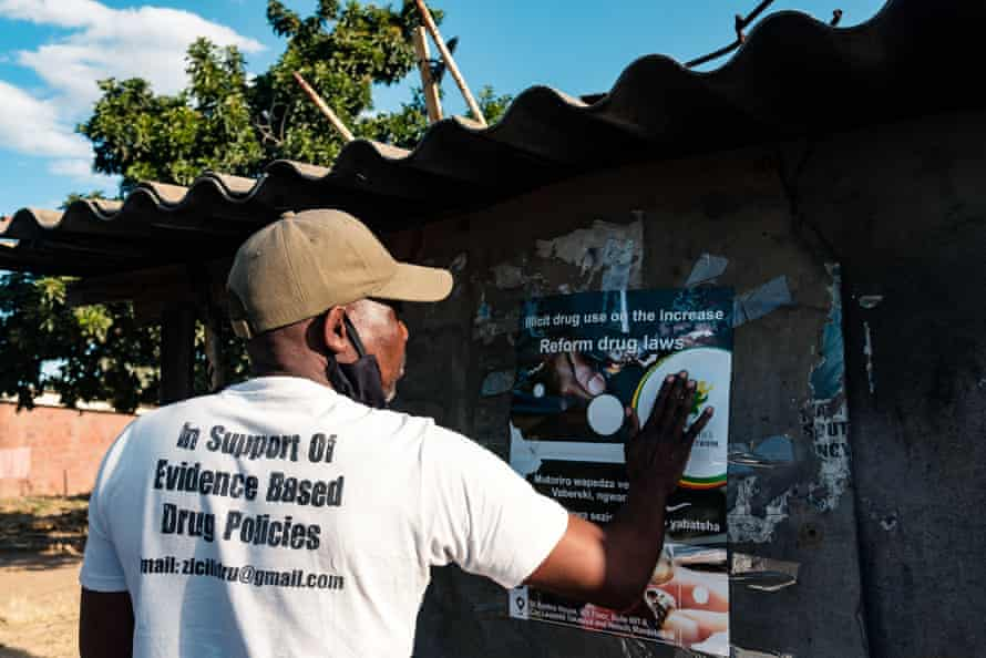 Posters warning of the dangers of crystal meth in Glen View township in Harare