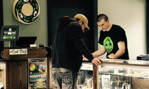 An Elevation staff member describes the locally produced product grown within an hour of the Native American owned and run cannabis store on the Squaxin Island tribe's reservation in Washington.