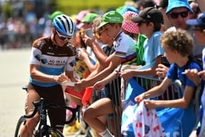 Stage 9: Saint-Étienne to Brioude, 170.5km Mathias Frank of AG2R La Mondiale signs an autograph for a young fan