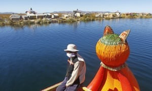 An man returns to his home on one of the many Uros islands on Lake Titicaca, near Puno, Peru on 4 July 2020.