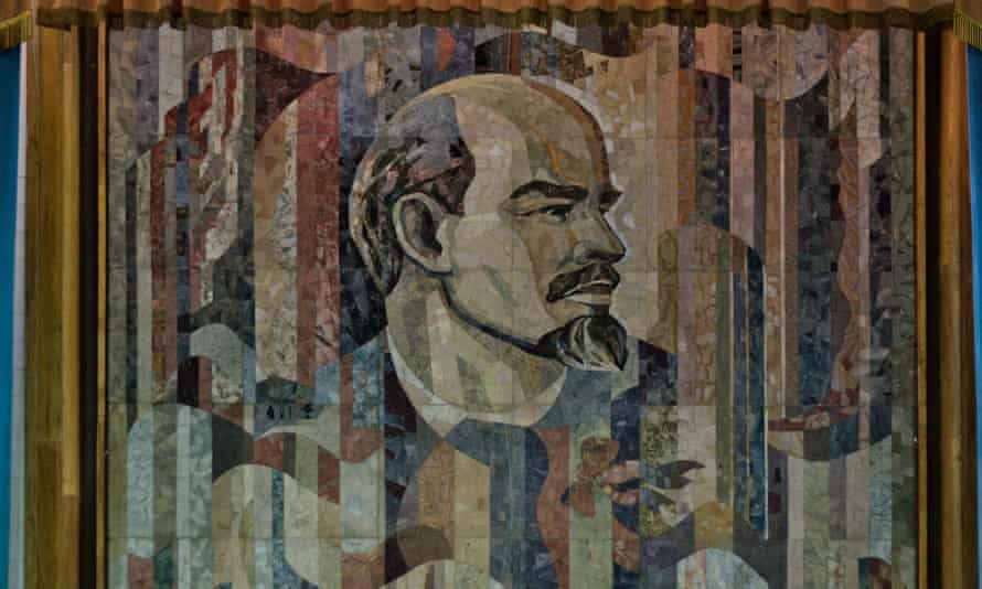 The rediscovered Lenin mosaic at the Kazakhstan Academy of Science, Almaty, complete with curtain to hide it from public gaze.