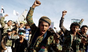 Houthi fighters shout slogans as they attend a rally in Sana'a