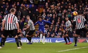Willian curls in Chelsea's second goal.
