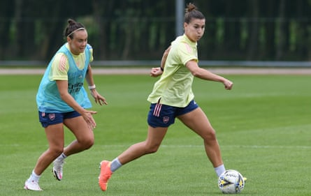 Arsenal's new signing Steph Catley moves away from Caitlin Foord during a training session earlier this week.