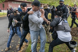 Portland, US A member of the Proud Boys tackles a fellow member after he assaulted the freelance journalist Justin Katigbak, right, during a Proud Boy rally in Oregon. The governor of Oregon, Kate Brown, declared a state of emergency prior to Saturdays rally as fears of political violence between Proud Boys and Black Lives Matter protesters grew