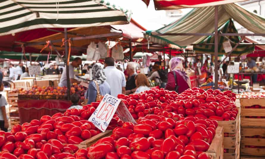 Tomatoes on sale at a market in Turin.