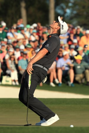 Justin Rose reacts to his missed birdie putt on the 18th