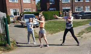A socially distant doorstep dance session in Leeds, run by youth work charity Barca.