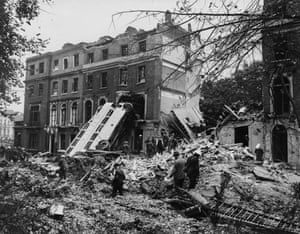 A bus is left leaning against the side of a building in the aftermath of a German bombing raid on London in the first days of the Blitz, London