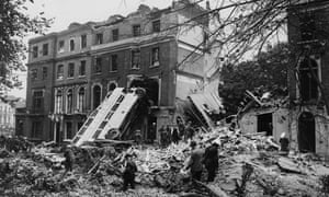 A ruined bus against the side of a building after a German bombing raid on London in the first days of the Blitz, 9th September 1940