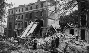 A bus is left leaning against the side of a building in the aftermath of a German bombing raid on London in the first days of the Blitz, 9th September 1940.