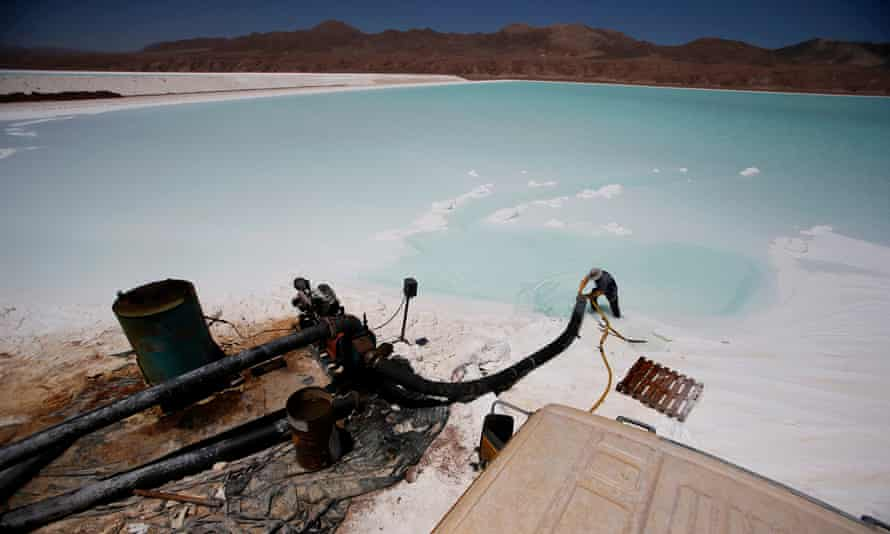 A worker cleans a pipe at a brine pool of the Rockwood lithium plant on the Atacama salt flat.
