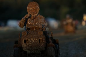Helen Sorrell of Team Phoenix struggles to see as mud from the wet track clogs her visor.