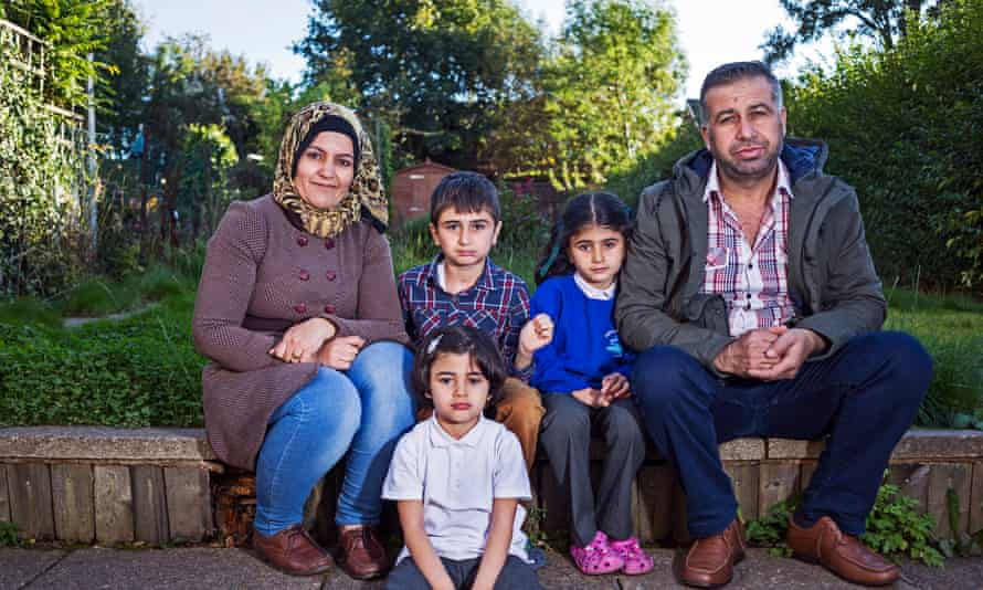 Syrian Kurdish refugee family in Coventry. Ahlam Kinjo and Khalid Abdulrahman, with their children Bilind, Lian and Vian.