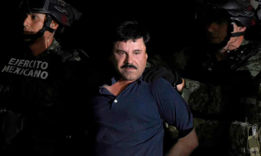 Joaquin 'El Chapo' Guzmán is escorted into a helicopter at Mexico City's airport following his recapture on 8 January 2016.